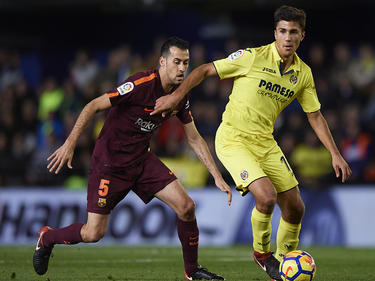Sergio Busquets (l.) ist mit dem FC Barcelona auf Titelkurs in Spanien